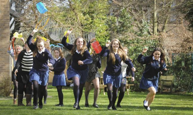 07/03/14 St Mary's School flying kites across its ground to mark International Women's Day on Saturday. Picture ltr Charlotte Connell 14, Ella Harrison 14, Celeste Cottham-Cartledge 15 and Maegan (correct) Curtis-Griffiths 15.  Picture: Keith Heppell