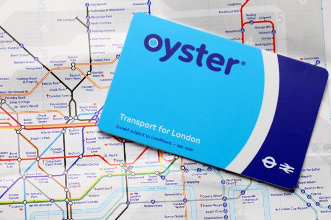 """""""London, United Kingdom- August 12, 2011: The Oyster card is a credit card sized electronic payment system used on public transport throughout the city of London. The London tube map represents the lines and stations of the London underground system."""""""